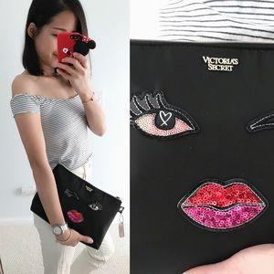 Victoria's Secret eye lip embellished clutch bag